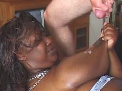 Fat black slut gets cum on table