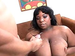Fat ebony whore gets cum on giant melons